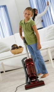 Girl Vacuuming Carpet